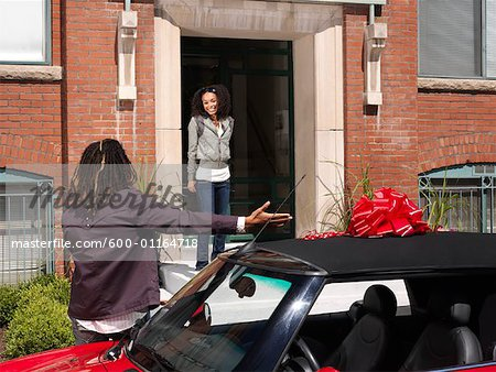 Man Giving Woman New Car Stock Photo - Premium Royalty-Free, Image code: 600-01164718
