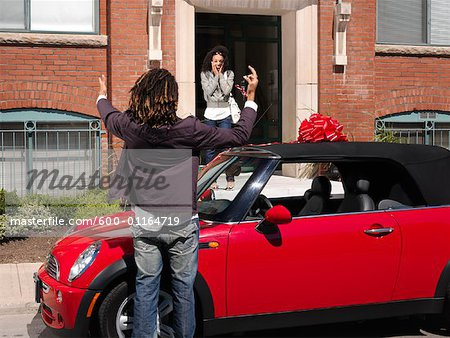 Man Giving Woman New Car Stock Photo - Premium Royalty-Free, Image code: 600-01164719
