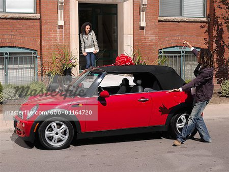 Man Giving Woman New Car Stock Photo - Premium Royalty-Free, Image code: 600-01164720