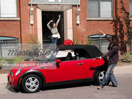 Man Giving Woman New Car Stock Photo - Premium Royalty-Free, Image code: 600-01164721