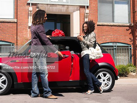 Man Giving Woman New Car Stock Photo - Premium Royalty-Free, Image code: 600-01164722
