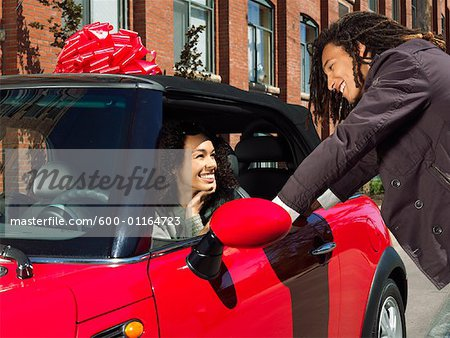 Man Giving Woman New Car Stock Photo - Premium Royalty-Free, Image code: 600-01164723