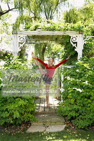 Girl Doing Gymnastics Outdoors Stock Photo - Premium Royalty-Free, Image code: 600-01173698
