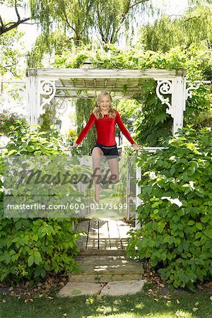Girl Doing Gymnastics Outdoors Stock Photo - Premium Royalty-Free, Image code: 600-01173699