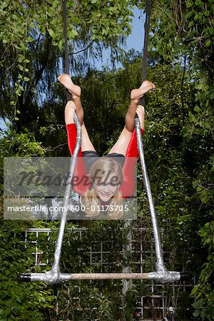 Girl Doing Gymnastics Outdoors Stock Photo - Premium Royalty-Free, Image code: 600-01173705