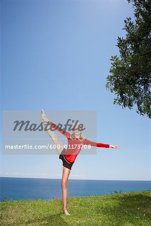 Girl Doing Gymnastics Outdoors Stock Photo - Premium Royalty-Free, Image code: 600-01173708