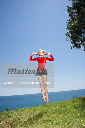 Girl Doing Gymnastics Outdoors Stock Photo - Premium Royalty-Free, Image code: 600-01173709