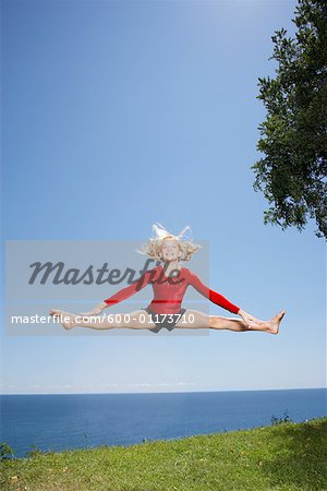 Girl Doing Gymnastics Outdoors Stock Photo - Premium Royalty-Free, Image code: 600-01173710