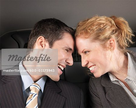 Man and Woman in Car Stock Photo - Premium Royalty-Free, Image code: 600-01173943