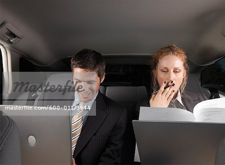 Businesspeople Working in Back of Car Stock Photo - Premium Royalty-Free, Image code: 600-01173944