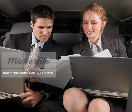 Businesspeople Working in Back of Car Stock Photo - Premium Royalty-Free, Image code: 600-01173945