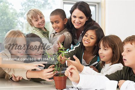 Students and Teacher with Plant in Classroom
