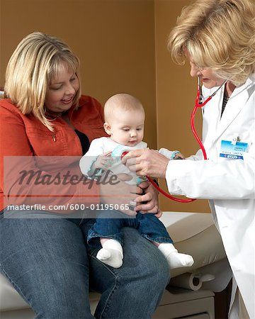 Doctor Examining Baby Stock Photo - Premium Royalty-Free, Image code: 600-01195065