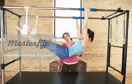 Woman Exercising With Pilates Instructor Stock Photo - Premium Royalty-Free, Image code: 600-01195422