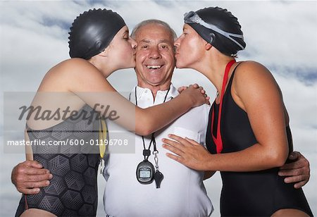 Swimmers Kissing Coach Stock Photo - Premium Royalty-Free, Image code: 600-01196708