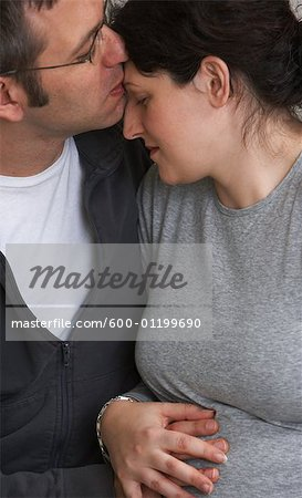 Husband Kissing Pregnant Wife Stock Photo - Premium Royalty-Free, Image code: 600-01199690