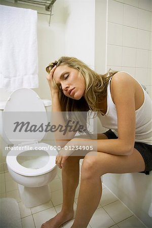 Sick Woman in Bathroom Stock Photo - Premium Royalty-Free, Image code: 600-01234905