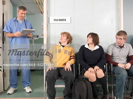Doctor Calling Next Patient Stock Photo - Premium Royalty-Free, Image code: 600-01236179