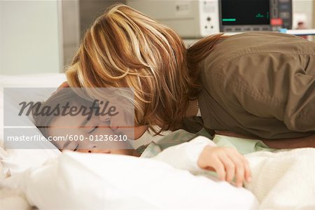 Mother Kissing Son in Hospital Stock Photo - Premium Royalty-Free, Image code: 600-01236210