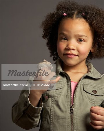 Girl Holding Hamster Stock Photo - Premium Royalty-Free, Image code: 600-01236610