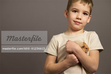 Portrait of Boy Holding Hamster Stock Photo - Premium Royalty-Free, Image code: 600-01236613