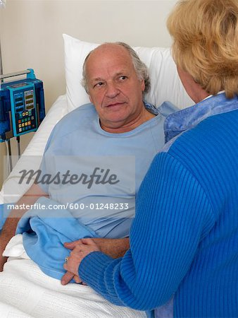 Woman with Sick Man in Hospital Room Stock Photo - Premium Royalty-Free, Image code: 600-01248233