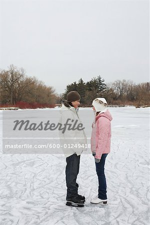 Couple Looking at Each Other on Ice Rink Stock Photo - Premium Royalty-Free, Image code: 600-01249418