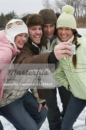 Friends Taking Pictures Stock Photo - Premium Royalty-Free, Image code: 600-01249429