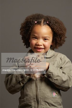 Girl Holding Hamster Stock Photo - Premium Royalty-Free, Image code: 600-01275389