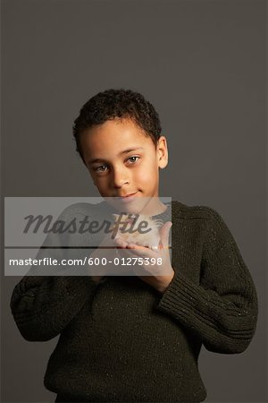 Little Boy Holding Hamster Stock Photo - Premium Royalty-Free, Image code: 600-01275398