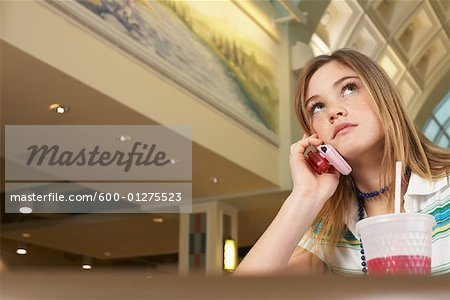Teenager Using Cell Phone Stock Photo - Premium Royalty-Free, Image code: 600-01275523