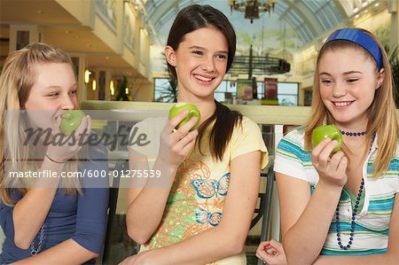 Teenagers Eating Apples Stock Photo - Premium Royalty-Free, Image code: 600-01275539