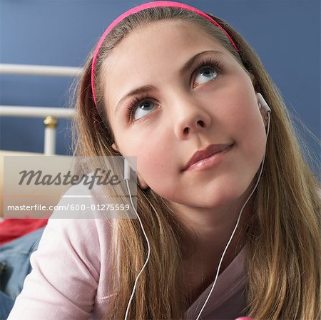 Girl with Headphones Stock Photo - Premium Royalty-Free, Image code: 600-01275559