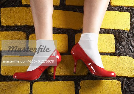 Red Shoes on Yellow Bricks Stock Photo - Premium Royalty-Free, Image code: 600-01275978