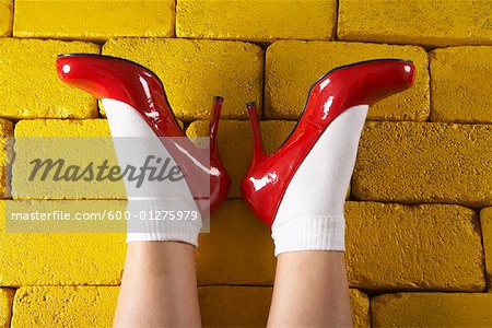 Red Shoes on Yellow Bricks Stock Photo - Premium Royalty-Free, Image code: 600-01275979