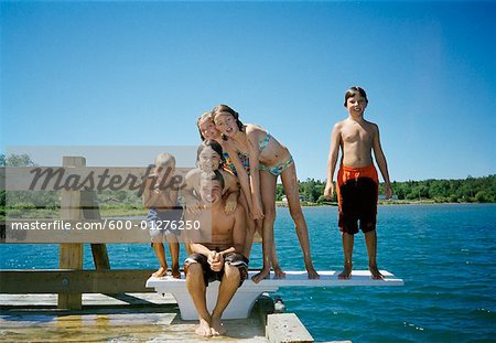 Children on Dock Stock Photo - Premium Royalty-Free, Image code: 600-01276250
