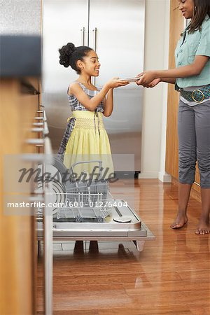 Sisters Unloading Dishwasher Stock Photo - Premium Royalty-Free, Image code: 600-01276404