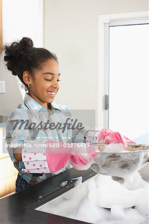 Girl Washing Dishes Stock Photo - Premium Royalty-Free, Image code: 600-01276413