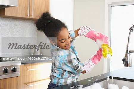 Girl Washing Dishes Stock Photo - Premium Royalty-Free, Image code: 600-01276414