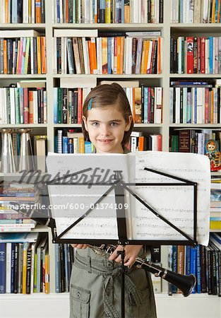 Girl Holding Clarinet Stock Photo - Premium Royalty-Free, Image code: 600-01374109