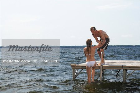 Couple Swimming in Lake Stock Photo - Premium Royalty-Free, Image code: 600-01585698