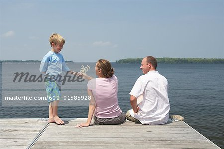 Family on Dock Stock Photo - Premium Royalty-Free, Image code: 600-01585928