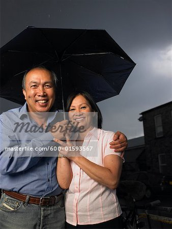 Portrait of Couple in Rain Stock Photo - Premium Royalty-Free, Image code: 600-01593567