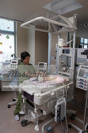 Nurse Practicing with Baby Mannequin Stock Photo - Premium Royalty-Free, Image code: 600-01595844