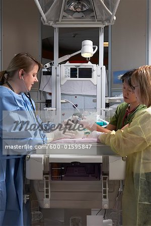 Nurses Practicing on Baby Mannequin Stock Photo - Premium Royalty-Free, Image code: 600-01595847