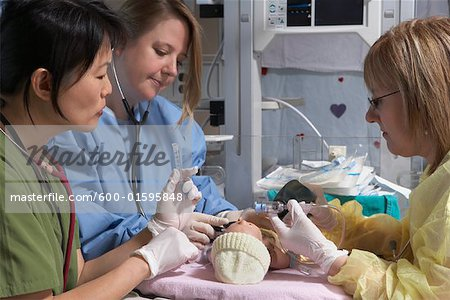 Nurses Practicing on Baby Mannequin Stock Photo - Premium Royalty-Free, Image code: 600-01595848