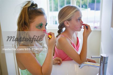 Girls Applying Clown Make-up Stock Photo - Premium Royalty-Free, Image code: 600-01603927
