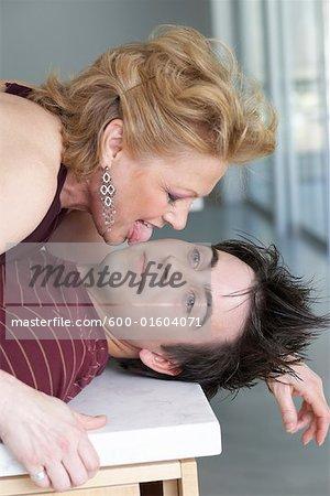 Woman Licking Man's Face