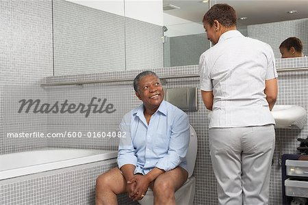 Couple in Washroom Stock Photo - Premium Royalty-Free, Image code: 600-01604082
