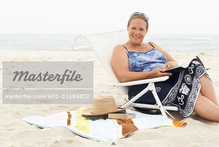 Portrait of Woman on the Beach Stock Photo - Premium Royalty-Free, Image code: 600-01606832